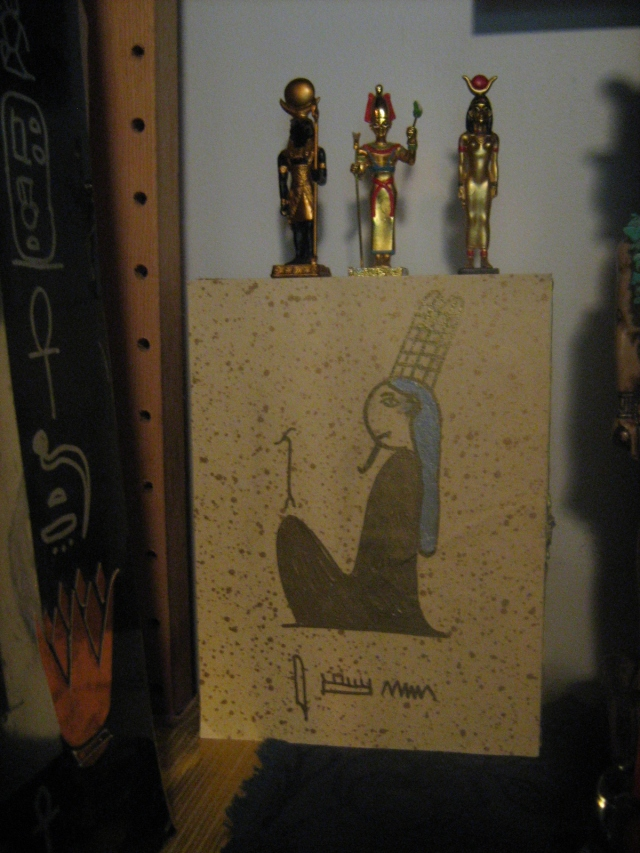 Box shrine for Amun, painted and covered with paper and hieroglyphs