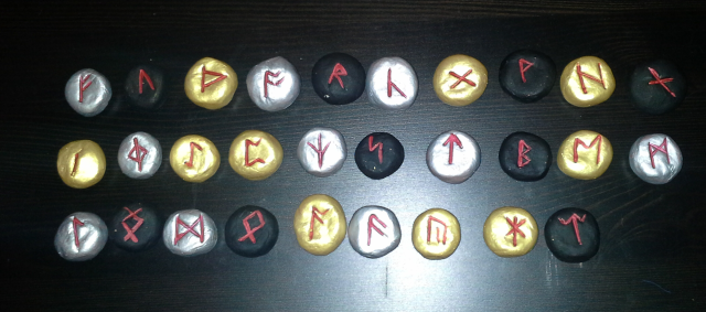 A set of painted Saxon runes for divination. Each rune is about 3cm in diameter, though they are all individually handmade.